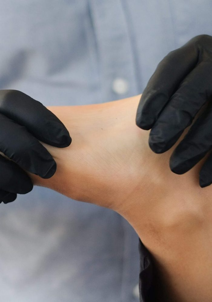 Dancer receiving physiotherapy on foot